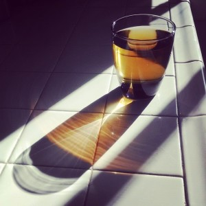 Pic I took of a glass of apple juice being penetrated by the afternoon light.